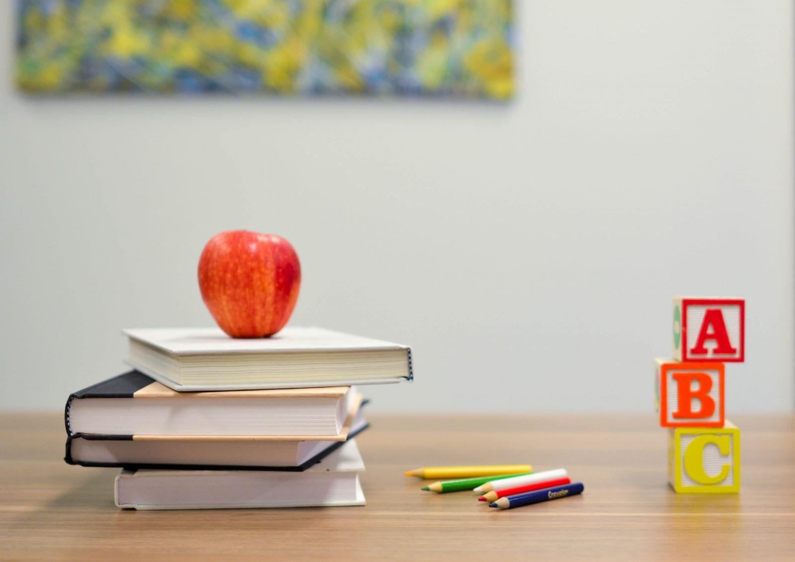 Apple Blocks and Books on Table